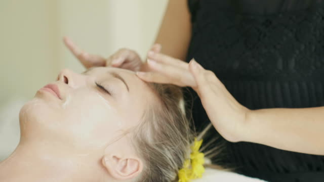 close up of beautiful woman with her head massage for relaxation and leisure activity-beauty and spa therapy service - head massage stock videos and b-roll footage