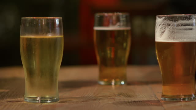 Close up of beer glasses in and in traditional English pub