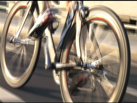 close up of bicycle wheel spinning during the 2009 honolulu triathlon on january 01 2012 - salmini stock videos and b-roll footage