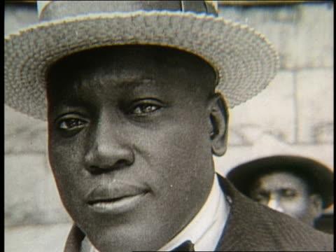 close up of black man in straw hat / jack johnson - アメリカ黒人の歴史点の映像素材/bロール