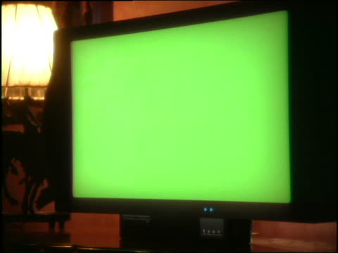 close up of blank green computer/television screen - television chroma key stock videos & royalty-free footage