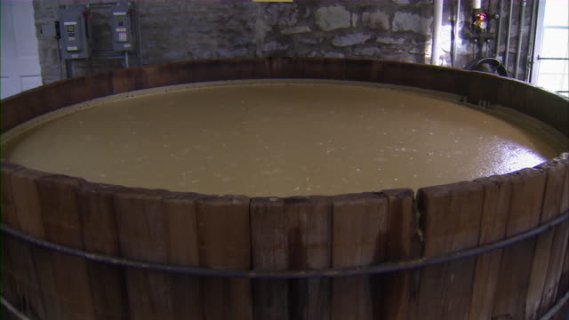 close up of bourbon being distilled in large vat. - kentucky stock videos & royalty-free footage