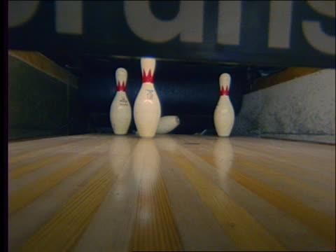 close up of bowling ball hitting pins + lane being cleared - bowling ball stock videos & royalty-free footage