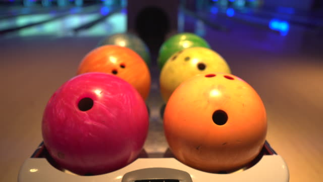 close up of bowling balls at ten pin bowling alley - bowling alley stock videos & royalty-free footage