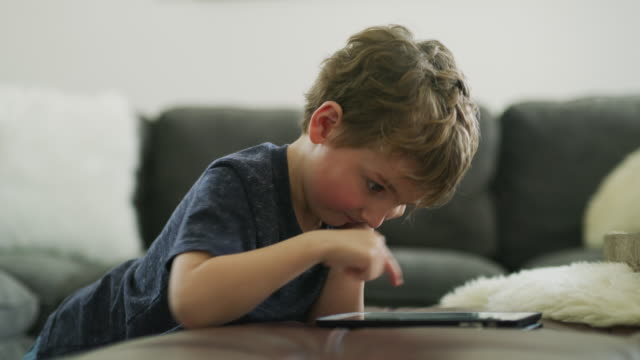close up of boy drawing on digital tablet / pleasant grove, utah, united states - nursery school child stock videos & royalty-free footage
