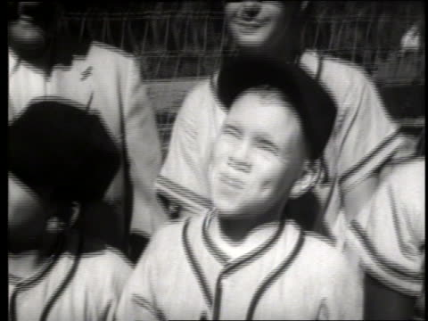 vidéos et rushes de b/w close up of boys in baseball uniforms looking up, smiling / sacramento / sound - casquette de baseball