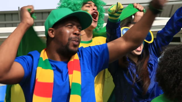 close up of brazilian fans cheering - hand fan stock videos and b-roll footage