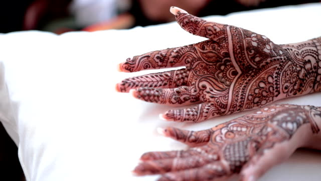close up of bride's hand with henna painted, mehndi. - body adornment stock videos and b-roll footage