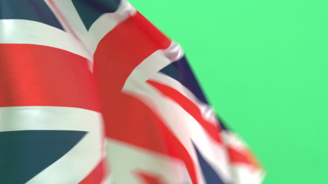 vidéos et rushes de close up of british, uk flag on green screen - angleterre