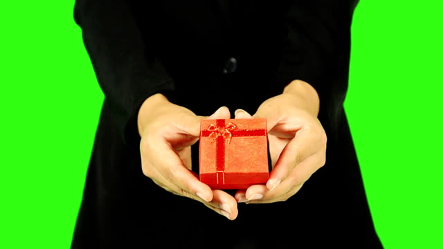 close up of business woman giving a gift - keyable stock videos & royalty-free footage