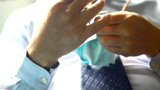 close up of businessman hands holding eyeglasses - contact lens case stock videos and b-roll footage