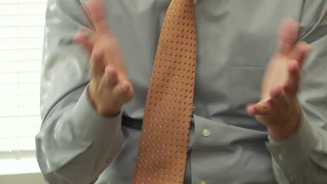 close up of businessman making hand gestures - giuntura umana video stock e b–roll