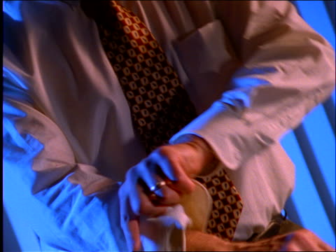 close up of businessman rolling up sleeve - nur männer über 30 stock-videos und b-roll-filmmaterial