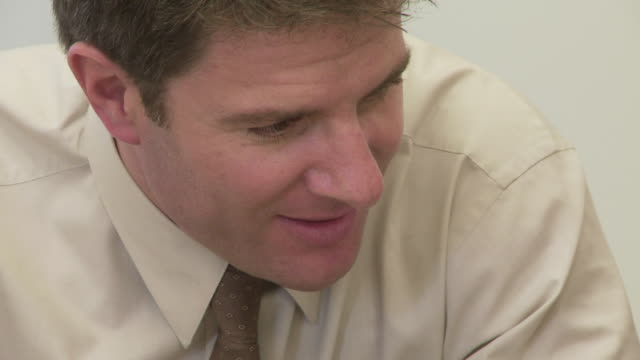close up of businessman talking and laughing - formal businesswear stock videos & royalty-free footage