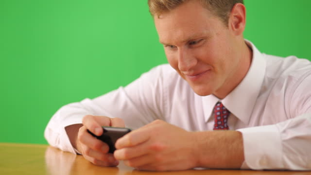 close up of businessman text messaging on cell phone - text messaging video stock e b–roll