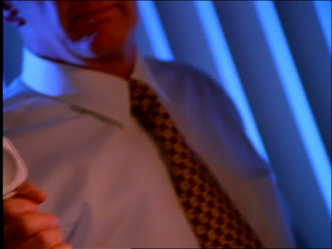 close up of businessman thrusting phone receiver toward camera - nur männer über 30 stock-videos und b-roll-filmmaterial