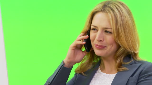 close up of businesswoman talking on phone at desk - only mid adult women stock videos and b-roll footage