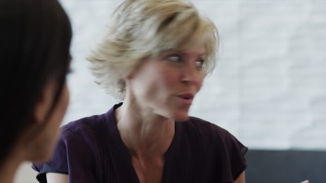 close up of businesswoman talking to co-workers / provo, utah, united states,  - provo stock videos and b-roll footage