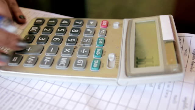 Close up of Businesswoman working on calculator,Dolly Shot