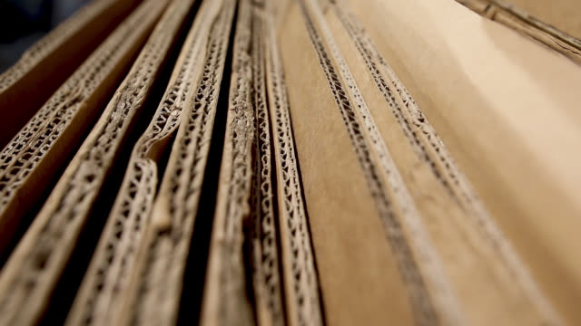 close up of cardboards, stacked and ready for recycle - cardboard box stock videos & royalty-free footage