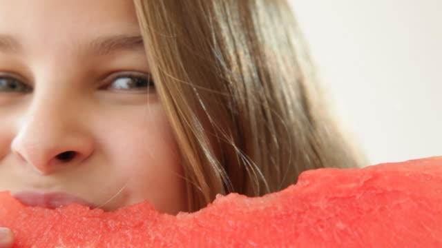 Close up of Caucasian girl eating watermelon