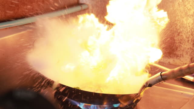 slo mo close up of chef cooking night street food - metal industry stock videos & royalty-free footage