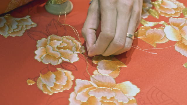 close up of chinese craftsman embroidering a wedding dress - intricacy stock videos & royalty-free footage