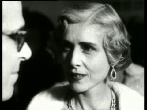 1955 b/w close up of clare boothe luce in formalwear smiling at vienna opera / no sound - luce stock videos & royalty-free footage