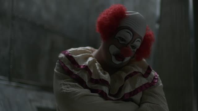 close up of clown sitting in mental asylum wearing straight jacket / cedar hills, utah, united states - clown stock videos & royalty-free footage