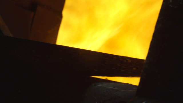 Close up of coal being put into a steam train furnace