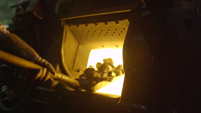 close up of coal being put into a steam train furnace - locomotive stock videos & royalty-free footage