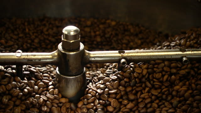close up of coffee beans in roaster - ugnsstekt bildbanksvideor och videomaterial från bakom kulisserna