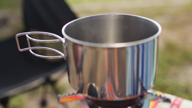 close up of coffee boiling on a camping stove - portability stock videos & royalty-free footage