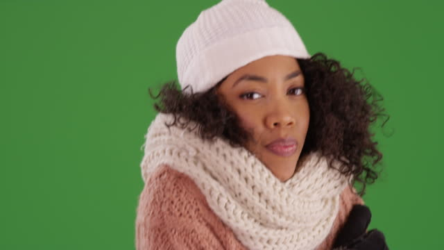 close up of cold woman shivering in winter clothes on green screen background - shivering stock videos & royalty-free footage
