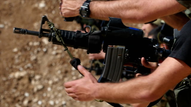 Close up of Commando army soldiers in training, on a military firing range shooting at a target/ Israel IDF ,Slow motion