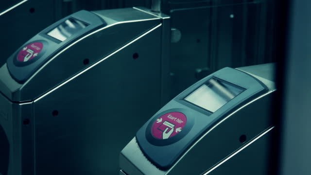 close up of commuter touching transport card on reader - id card stock videos and b-roll footage