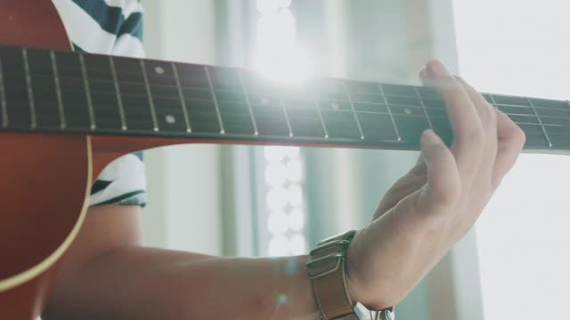 close up of composer man is creating music while playing guitar - classical style stock videos & royalty-free footage