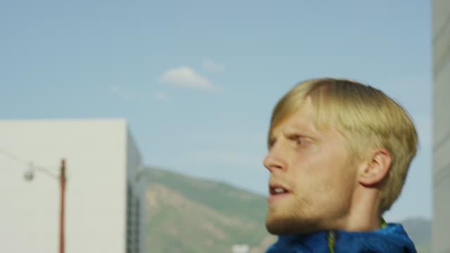 Close up of couple running in urban city / Salt Lake City, Utah, United States