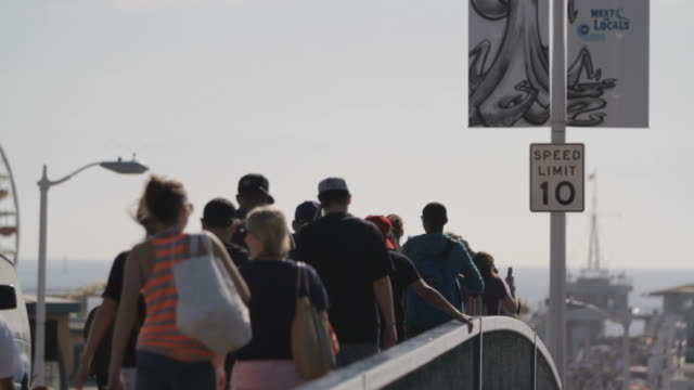 close up of crowd interacting on brigde - speed limit sign stock videos & royalty-free footage