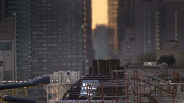 Close Up of Cruise Ship Exhaust Distorting Manhattan Skyline
