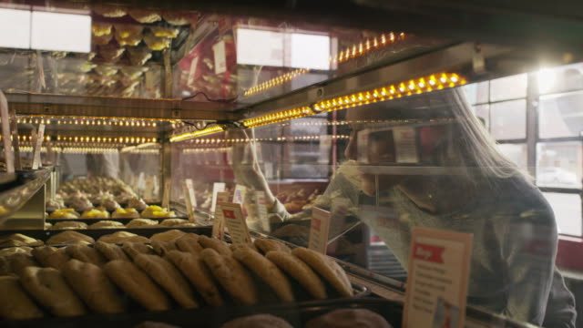 close up of customer browsing bakery display case / salt lake city, utah, united states - one mid adult man only stock videos & royalty-free footage