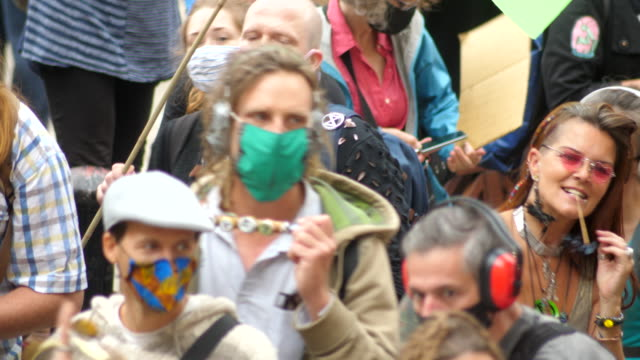 close up of dancers extinction rebellion protest london 2020 out side the bank of england with drummers and colourful flags - campaigner stock videos & royalty-free footage