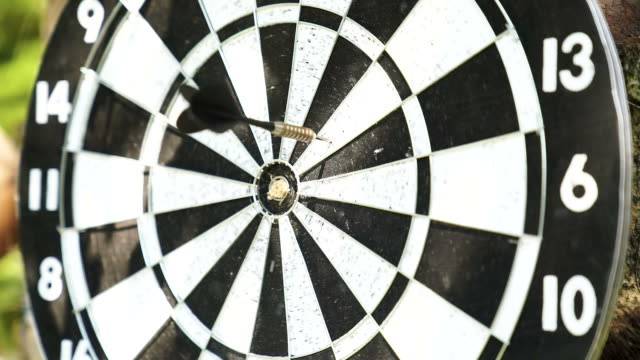 close up of darts hitting the bulls eye on a dartboard - dart board stock videos & royalty-free footage