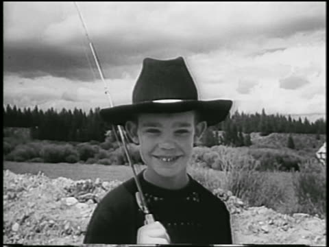 b/w 1954 close up of david eisenhower in cowboy hat holding fishing rod outdoors / colorado / newsreel - 1954 stock videos & royalty-free footage
