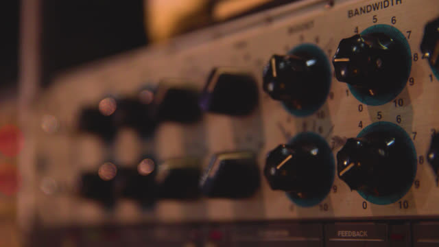close up of dials on a sound mixing unit - machine part stock videos and b-roll footage