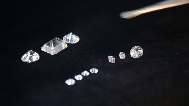 Close up of diamonds as an employee checks the quality at the Antwerp World Diamond Center in the diamond district of Antwerp Belgium on Thursday...