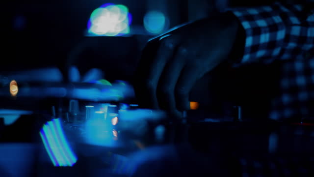 close up of dj's hands on crossfader of turntables - dj stock videos & royalty-free footage