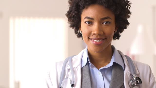 close up of doctor smiling - front view stock videos & royalty-free footage
