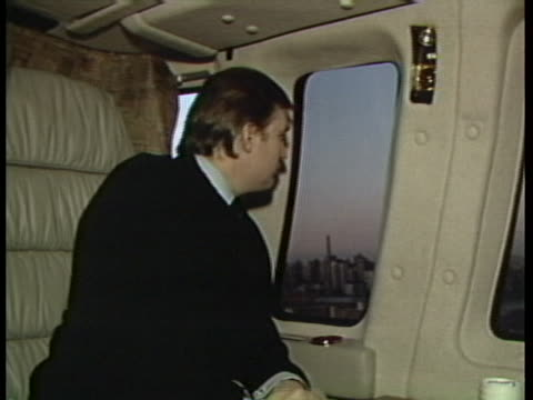 close up of donald trump, sitting in a private aircraft . he says something before turning his head and looking out the window. cut to medium shot of... - businessman stock videos & royalty-free footage