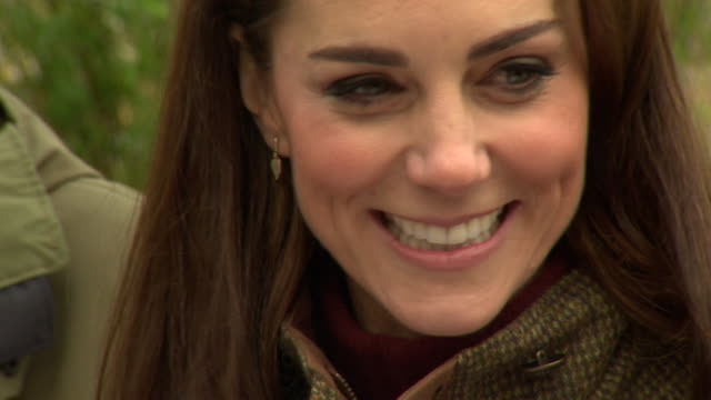 close up of duchess of cambridge smiling and laughing during visit to king henry's walk garden in islington - キャサリン妃点の映像素材/bロール